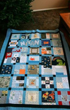 Memory Quilt made from baby clothes Twin Size. $300.00, via Etsy.
