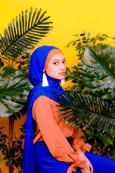 Blue and Orange. Azure Blue with Burnt Sienna Orange Colour and tone for a Modest Fashion, Hijab Fashion. For Muslim Women all around the world, Muslimah, Modesty with Confidence. Ribbon Top, Hijab, Earrings, Tassle Earrings and Lycra Slim Pants Creative Portrait Photography, Creative Portraits, Instant Hijab, Modest Fashion Hijab, Orange Pants, Modest Wear, Chiffon Scarf, Hijab Outfit, Slim Pants