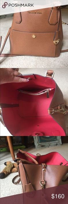 Michael kors handbag Excellent condition with a few pen marks in the inside, outside is like new Michael Kors Bags Shoulder Bags