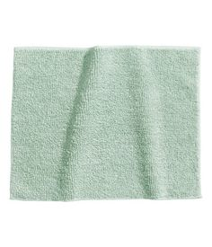 Mint green. Bath mat in thick cotton terry with taped trim.