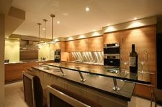 Sleek contemporary kitchen decor with wood on cabinets and double sink kitchen island