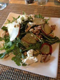 Arugala pear salad with goat cheese, walnuts, and citrus vinaigrette