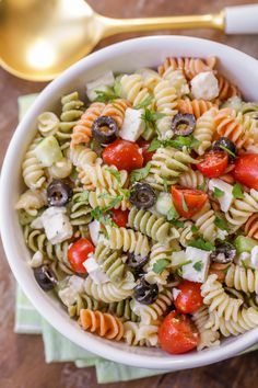 Greek Pasta Salad - rotini pasta, tomatoes, cucumber, olives, and feta cheese in a delicious greek dressing! This will be your new go-to pasta salad!!