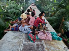 """National Geographic Photo of the Day: """"Riding High"""" by A. Ahad, 29 November 2015 - The lush greenery of Bangladesh blurs past riders atop a train near Dhaka. Photographie National Geographic, National Geographic Photography, National Geographic Photo Contest, National Geographic Travel, Photography Competitions, Photography Contests, Amazing Photography, Travel Photography, Photography Tips"""
