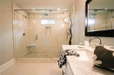 Transitional 3/4 Bathroom with Handheld showerhead, Flat panel cabinets, High ceiling, simple marble floors, Flush