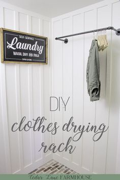 Laundry Room Clothes Drying Rack DIY Galvanized Pipe Clothes Drying Rack & This pipe clothes drying rack is an inexpensive way to add some instant character to your laundry room & The post Laundry Room Clothes Drying Rack appeared first on Home decor. Laundry Room Remodel, Laundry Room Cabinets, Laundry Room Organization, Laundry Room Design, Laundry In Bathroom, Laundry Room Wall Decor, Farmhouse Laundry Rooms, Diy Organization, Bathroom Storage
