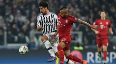 Sami Khedira of Juventus in action with Arturo Vidal (R) of Bayern during their UEFA Champions League round of 16 first leg