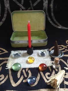 Travel Altar by KatsLittleSweets on Etsy- another idea for childs altar...I love the colored flat marbles representing the elements