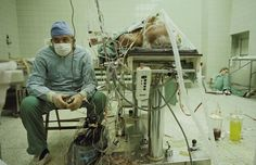 Heart surgeon after 23-hour-long (successful) heart transplant. His assistant is sleeping in the corner.
