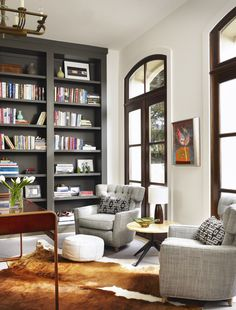 built-in grey bookcase + neutral decor by mark ashby design