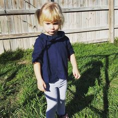 This Navy Ruffle Collar Blouse is sure to be a new favorite in your childs wardrobe! Made from high quality Japanese Kobayashi cotton double gauze, the handmade top brings comfort and style to your infant or toddler.  Double gauze is a wonderfully soft and cozy fabric with beautiful drape! Its perfect for baby and childrens apparel and accessories.  This handmade blouse can be worn alone or paired with a cardigan for chilly days. Try wearing a pair of our printed ruffle bloomers and headband…