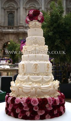 Amazing 8 tier Ivory and Gold Nigerian Wedding Cake at The Royal Exchange, London