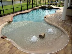 Nice small pool idea, perfect way to still have some yard area left for the kids to play. Plus its zero entry!