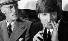 """John Lennon """"snorting coke"""" alongside Wilfrid Brambell, who played Paul McCartney's fictitious grandfather in The Beatles' film """"A Hard Day's Night,"""" 1964."""