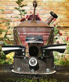 upcycled  birdhouse from vintage gas can & other whatnot--fabulous!!
