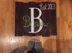 A personal favorite from my Etsy shop https://www.etsy.com/listing/262577581/monogram-last-name-off-centered-wooden