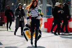 Woman wearing long colourful coat