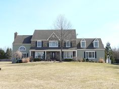 •CertainTeed Monogram Clapboard Vinyl Siding in Cypress •Raised panel black shutters •New gutters and leaders •Cultured stone facade and chimney •ThermaTru pre-finished classic craft fiberglass door