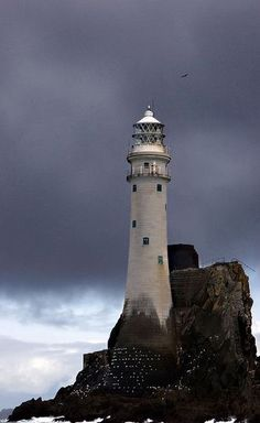The Fastnet Rock is miles southwest of Cape Clear and southwest of Mizen Head, County Cork, Ireland. The Fastnet Lighthouse is known as The Teardrop of Ireland, the last sight of Ireland for emigrants sailing to America. Lighthouse Pictures, Lighthouse Art, Lighthouse Keeper, Beacon Of Light, Water Tower, Belle Photo, Places To See, Beautiful Places, Scenery