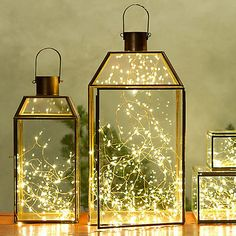 Fill glass lanterns with delicate tangles of lights instead of candles. Source: Terrain