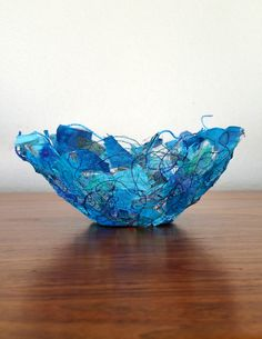 Round fabric bowl 7 x 3 gold or turquoise made with recycled materials by Textility. Distinctive lacey material with bright colors.