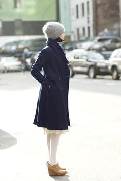 The Sartorialist December and still looking cute. I love her soft knit hat.
