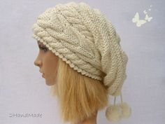 This hand knit hat features on an cable pattern and suits any outfit style. It is made of nice high quality cream/white (ivory) merino wool yarn ( 80%