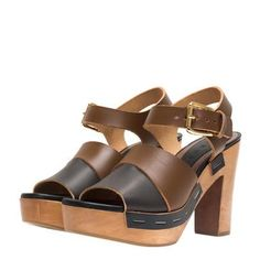 Brown and black leather clog with wooden heel