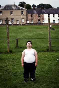 Stephen Lee playing hide and seek (2014), by Mattia Zoppellaro, from the series Appleby. He is pictured enjoying a game of hide and seek with his friends, at the Appleby Horse Fair in Westmoreland, an annual gathering for the Irish Traveller community. Taylor Wessing Photographic Portrait Prize 2015   Creative Review