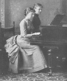 Amalie (right) with Marie Valerie at the piano