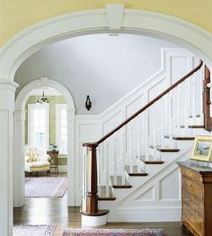 Wow, I want this molding in my house. The arches look so elegant and the paneling for the staircases is just perfect.