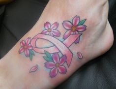 tattoos breast cancer ribbons | Ankle tattoo with pink ribbon in the middle of Flowers