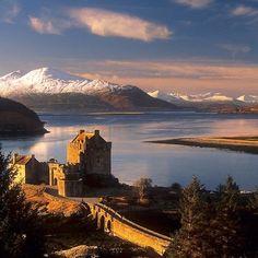 """ Eilean Donan Castle and the Isle of Skye, Winter. Highland Scotland."""