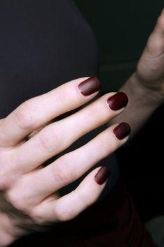 Matte burgundy nails.
