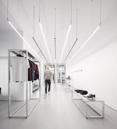 this streetwear store in porto portugal sets the stage for the minimalist clothing it offers. diogo aguiar studio designed the space with straight rigid lines in order to accentuate the store's high ceilings and expansive length. one gets the impression of a much larger space.