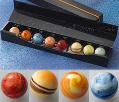 """Ever wonder what Uranus tastes like? Thanks to these chocolate planet balls, we now know that planet tastes like milk tea. Included in this tasty pack of geeky chocolates are eight different planets, each with their own unique flavour."""
