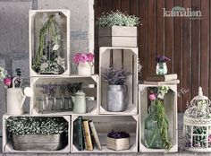 Good use of wooden crates to create a multi level display for a craft fair table.