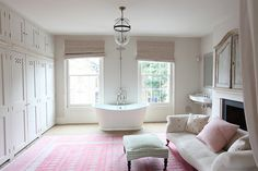 """This lovely London bedroom caught my eye and was immediately saved to my """"dream home"""" files. The houseis an unoccupied, unfinished space thatisused for photo shoots, but there's still so much to appreciate. I love the transition from the pale pink bedroom wallsto the grey bathroomwalls. The rug and pillow in the bathroom pull the …"""