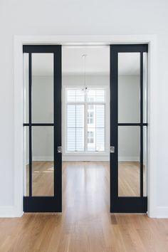 Sherwin Williams Cyberspace SW 7076 door paint color Sherwin Williams Cyberspace SW 7076 Sherwin Williams Cyberspace SW 7076 - August 18 2019 at Doors, Home, House Design, Interior, Door Design, House Interior, Glass Pocket Doors, Home And Family, Doors Interior