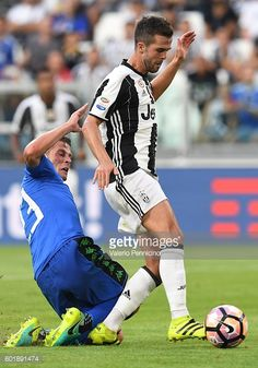 Miralem Pjanic of Juventus FC is challenged by Marcello Gazzola of US Sassuolo during the Serie A match between Juventus FC and US Sassuolo at...