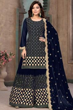 Get gorgeous in this dark blue georgette sharara suit which makes you appealing. This round neck and full sleeve wedding wear dress designed with zari and gota patti work. Set together with georgette sharara pant in dark blue color with dark blue georgette dupatta. Sharara pant has zari and gota patti work. #shararasuits #malaysia #Indianwear #weddingwear #andaazfashion Sharara Suit, Churidar Suits, Indian Attire, Indian Ethnic Wear, Pakistani Suits, Pakistani Salwar Kameez, Palazzo Suit, Palazzo Style, Pantalon Cigarette