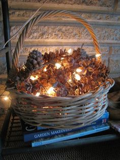 Put pinecones in a basket and gently wrap white Christmas lights throughout. You know what would be even easier and prettier? Twinkle lights around the pinecones!
