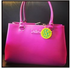 A happy clam monogram keychain is the perfect addition to a Kate spade handbag!!