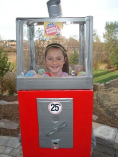 This Bubble Gum Machine was made by a 11 year old and her mother. It took a box, poster frames, lots of duct tape and much more. Best part is that the machine actually works. She has been a hit with other kids!