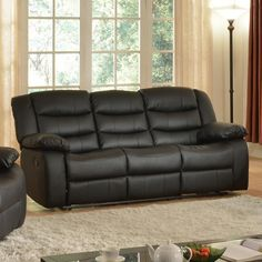 Sit back and relax on the Deacon Black Reclining Sofa with Drop Down Table. The black faux leather gives it a contemporary look. Drop down tray with 2 cup holders provides easy drink storage while reading or watching TV. Deacon Black Reclining Sofa with Drop | Weekends Only Furniture and Mattress