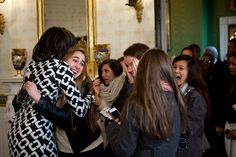 First Lady Michelle Obama greets visitors as they enter the Blue Room during their tour of the White House, Feb. 16, 2012. (Official White House Photo by Chuck Kennedy)