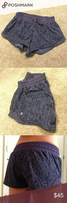 """Lululemon shorts Lululemon """"hotty hot short"""" 2.5 inch running shorts. These shorts are lined and have a zipper pocket in the back. Worn a handful of times. In excellent condition! lululemon athletica Shorts"""