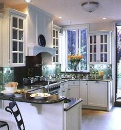 white kitchen cabinets with dark granite counter-- this makes me think that the black quartz with sparkles in it would look awesome with white cabinets