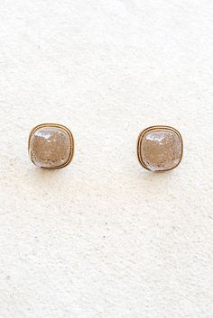 Druzy stones are the perfect compliment to just about any piece. These dark sand colored druzy stone stud earrings will adorn your ears perfectly. Gold framework. Post style back. -Measures 1/2""
