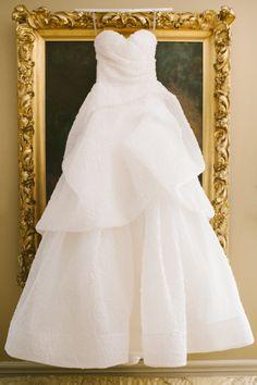 Stunning layered wedding dress: http://www.stylemepretty.com/2014/09/18/classic-romance-with-dash-of-sparkle/ | Photography: Rebecca Arthurs - http://rebecca-arthurs.com/